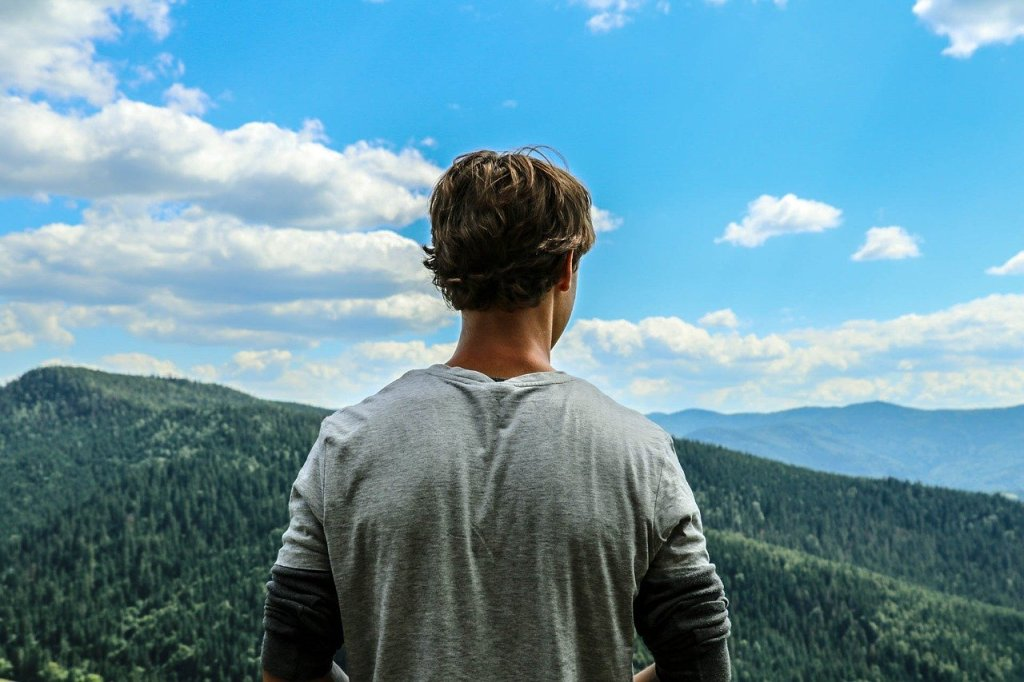 man looking over mountains