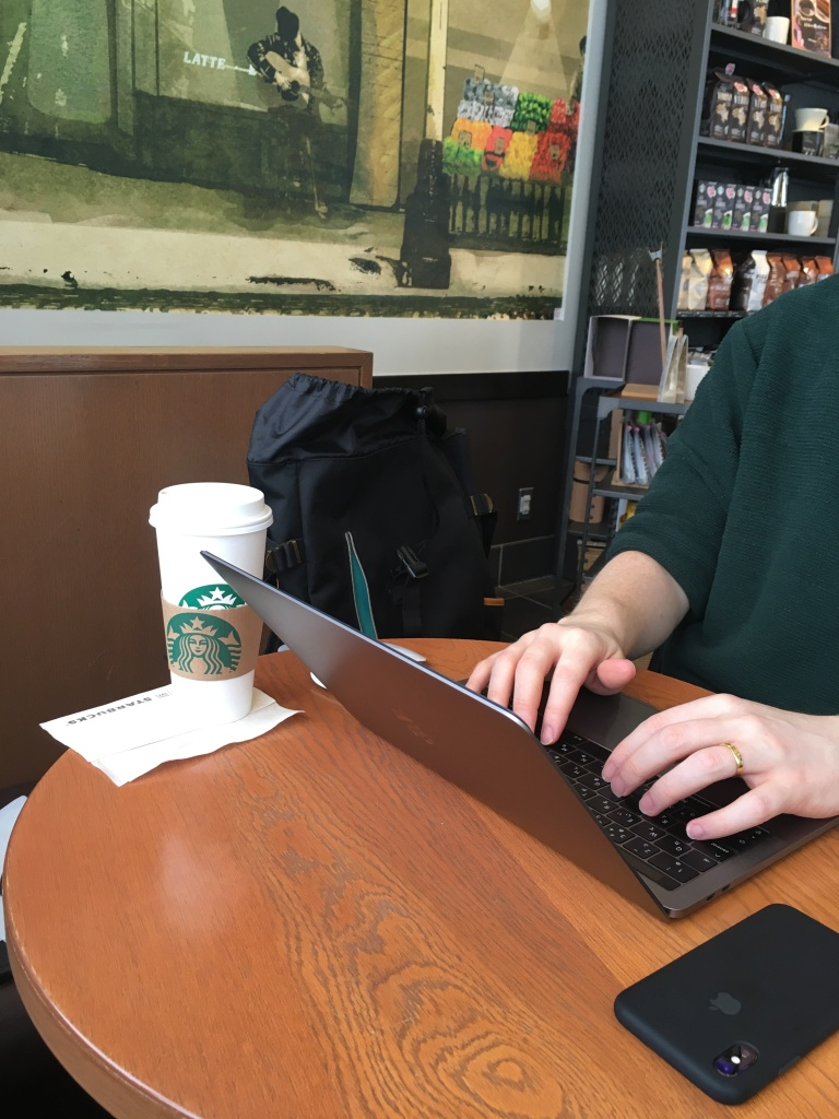 working on a laptop at Starbucks