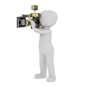 figure holding professional video camera
