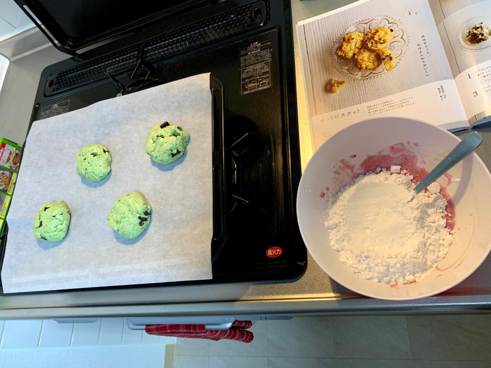 baking sheet with green biscuits