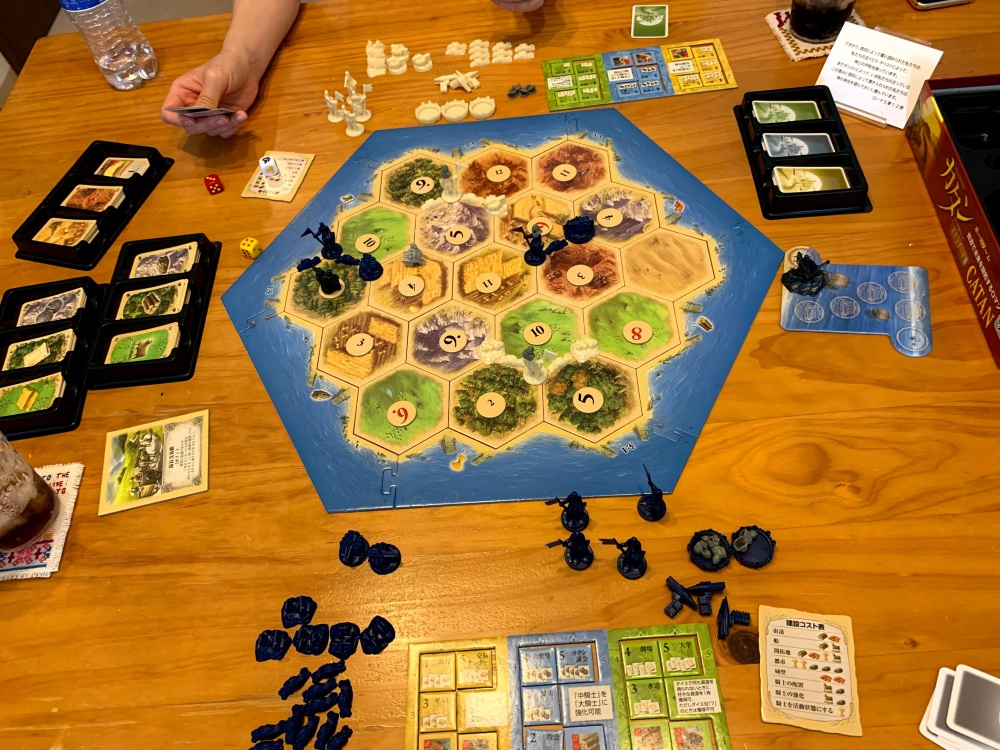 two people playing the Settlers of Catan board game