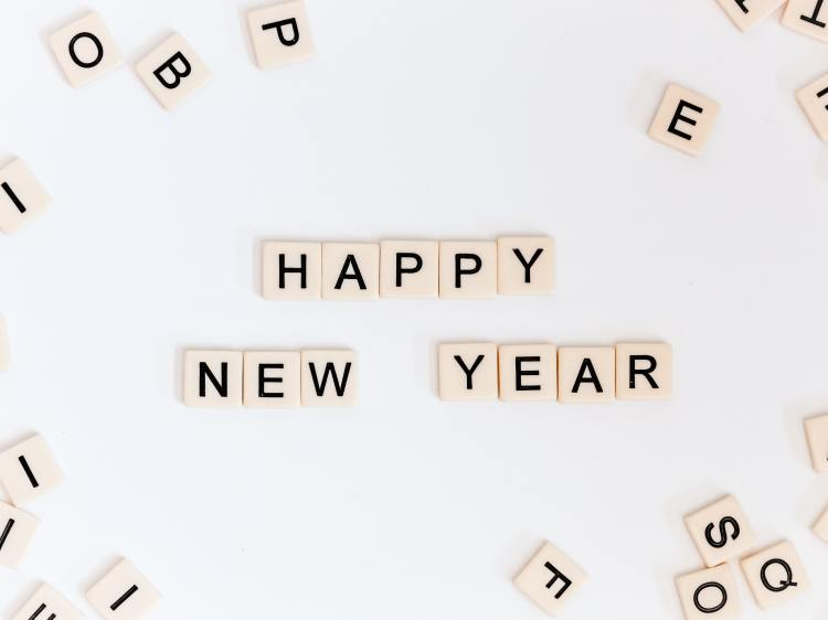 """Alphabet tiles spelling out """"Happy New Year"""""""